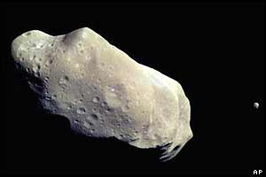 243 Ida asteroid (with Ida's moon Dactyl visible on the right)