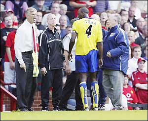 Vieira is escorted off the pitch
