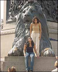Girls on bronze lion at Trafalgar Square