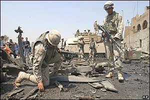 US soldier collect evidence at blast scene