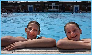 Two friends cool off at London's Brockwell Lido