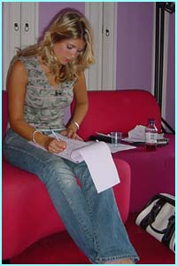 Holly's checking her script