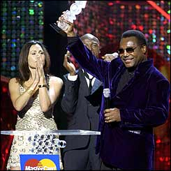 George Benson, with presenters Seal and Minnie Driver
