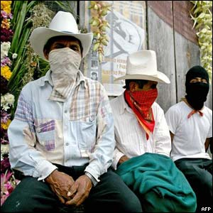 Members of the Zapatista National Liberation Army (EZLN) rest upon arrival at Oventic