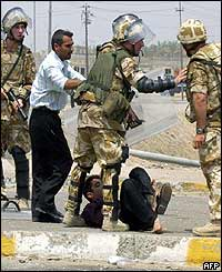 Iraqi youth being arrested down on the ground