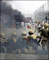 British soldiers face Iraqi rioters as tyres burn