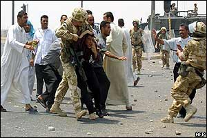 British soldiers detaining an Iraqi youth