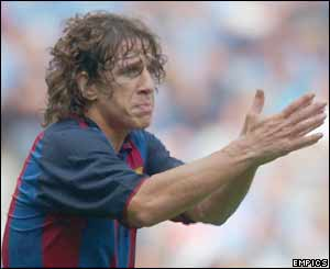 Carles Puyol in action against Manchester City