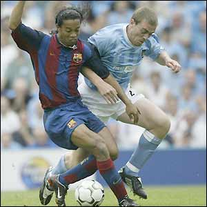 Barca's Ronaldinho is closely marked by City's Richard Dunne