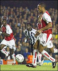 Thierry Henry chips in Arsenal's winner from the spot