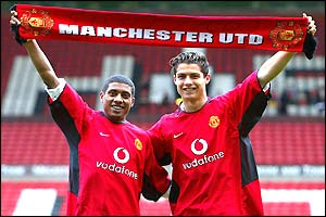 World Cup winner Kleberson and young Portuguese prodigy Cristiano Ronaldo pose at Old Trafford