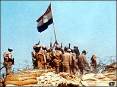 Egyptian soldiers raise a flag on Bar-Lev line bunker in Sinai