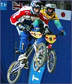 Two riders battle for position in mid-air