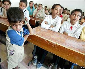 Son of teacher at front of Iraqi class