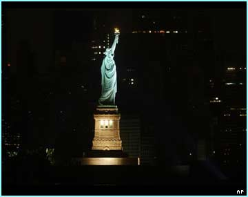 The statue of Liberty glows in the Manhattan blackout.