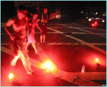 Emergency flares lights up the streets of New York to direct traffic.