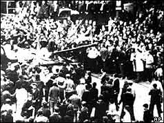 Crowds surround a Soviet tank