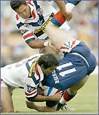Sydney Roosters' Shannon Hegarty and Brett Finch dish out a bone-crunching spear tackle