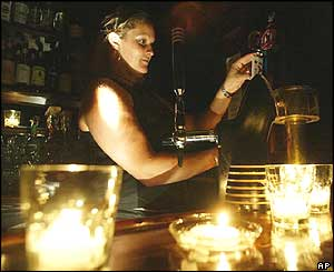 Toronto barmaid serves beers in candlelight