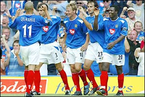 Portsmouth's Teddy Sheringham celebrates with team-mates after scoring against Aston Villa