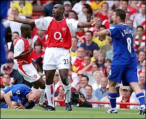 Arsenal's Sol Campbell protests his innocence after upending Everton's Thomas Gravesen