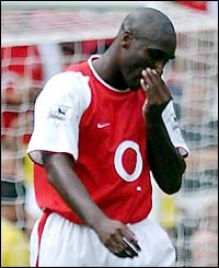 Arsenal's Sol Campbell leaves the field after being dismissed