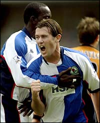 Blackburn's Brett Emerton celebrates scoring