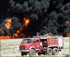 A fire truck parked at the scene of the second blaze next to the damaged oil pipeline near the northern Iraqi town of Baiji