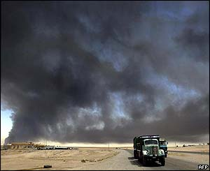 A huge black cloud of smoke rises up from the blaze on Iraq's key oil export pipeline to Turkey two days after an act of sabotage in Baiji