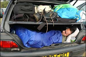 Fan sleeping in car boot