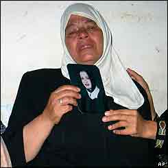 Mother holding the picture of the female suicide bomber who blew up the Haifa restaurant on Saturday