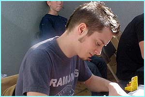 Elijah Wood (Frodo) settles down to some serious autograph signing