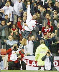 David Beckham punches the air with delight as he scores against Turkey at the Stadium of Light, Sunderland