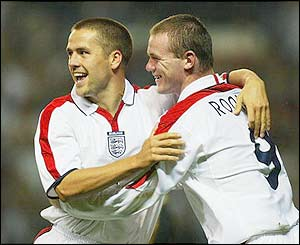England's Wayne Rooney congratulates Michael Owen as the Liverpool striker scores against Liechtenstein at Old Trafford