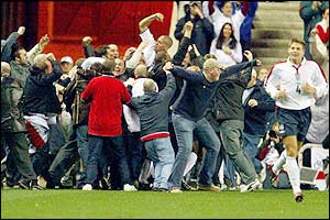 England fans invade the pitch to celebrate England second goal against Turkey