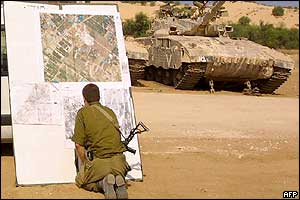Israeli soldier studies a map in Elei Sinai, north of the Gaza Strip