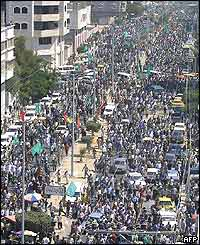 Mourners march through Gaza
