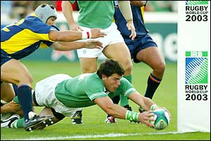 Shane Horgan dives over the line to score a try for Ireland