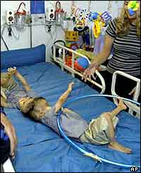 Conjoined Egyptian twins Mohamed (L) and Ahmed Ibrahim at their second birthday in Dallas in May 2003
