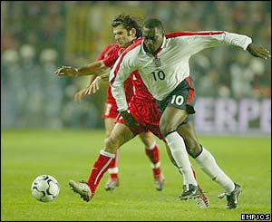 England's Emile Heskey gets the better of Turkey's Bulent