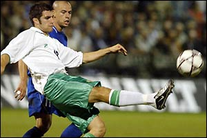 Northern's Ireland Aaron Hughes kicks the ball