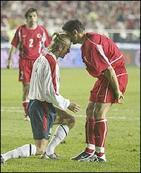 Beckham clashes heads with Turkey's Alpay