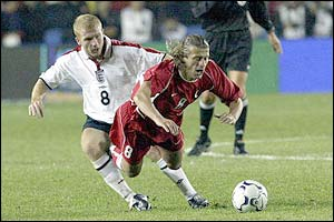 England's Paul Scholes fouls Tugay