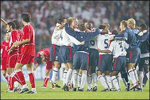 England celebrate their draw with Turkey