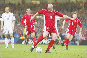 Wales' John Hartson scores from the penalty spot