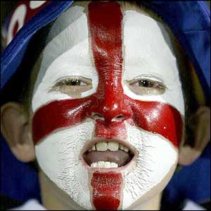 A young English fan cheers his team