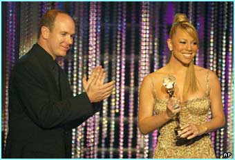 Prince Albert of Monaco presents a Diamond Award to Mariah Carey for over 150 million albums sold during her career