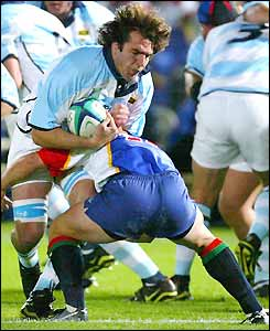 Pablo Bouza is tackled by a Namibian forward