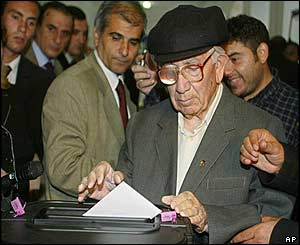 Man casts his vote in busy polling station