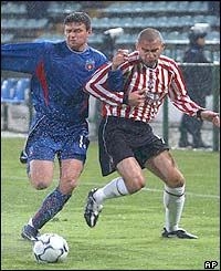 Danny Higginbotham takes on Steaua Bucharest defender Gabriel Bostina